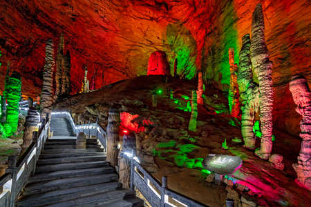 Zhangjiajie, China -  August 2019 : The iluminated trail path inside the stunning and beautiful Huanglong Yellow Dragon Cave called also the Wonder of the World`s Caves Éditoriale
