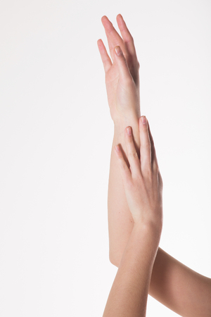 two womens hands on a white background. Empty hand isolated on white Stock Photo