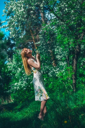 young woman in forest on a background of green foliage. Fashion for women Stock Photo