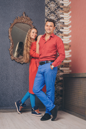 Fashion: portrait of a man and a woman. Pair in red