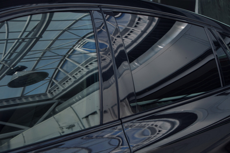 tinted black car Windows that reflect the glass ceiling
