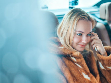 Portrait of a blue-eyed blonde. Beautiful girl looking at the camera. Woman with loose hair Stock Photo