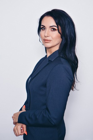 isolated photo: portrait of a smiling handsome woman in a business suit