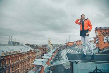 girl standing on the edge of the roof