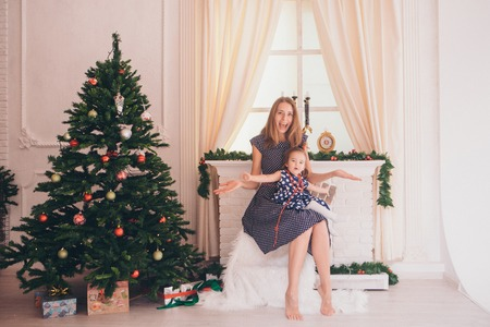 photo of a family through the branches of a Christmas tree Stock Photo