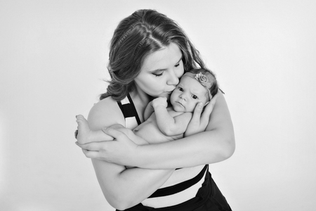 newborn baby in the arms of the mother. Woman holding a child