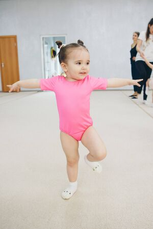 little girl engaged in recreational gymnastics. sports exercises and stretching: athletics Banco de Imagens
