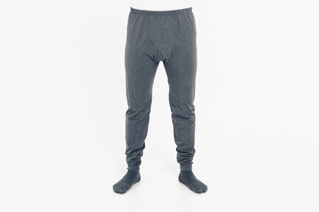 the concept of advertising clothing, fashion show - men's pants and socks. Pajamas on white background. Copy space