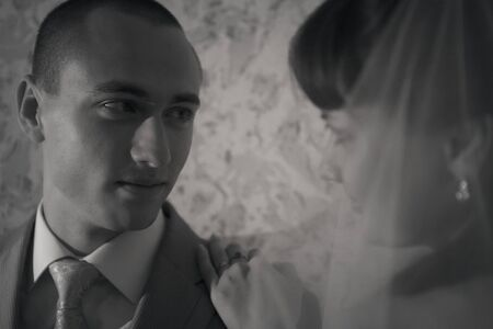 love the groom looking at the bride. A man admires a woman. The concept of family day, Valentines day, wedding