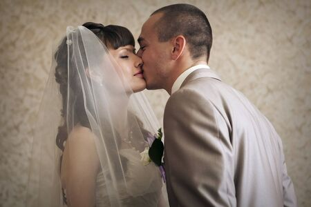 the groom kisses the bride. A man admires a woman. Family Day concept, Valentine's Day, wedding Stock Photo - 129621037
