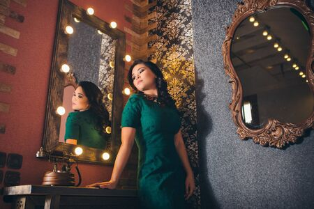fashionable stylish portrait of Asian woman. the model looks in the mirror. girl in reflection. concept work, modeling Stockfoto