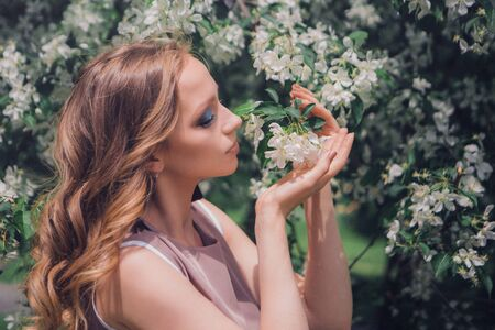 fatal beauty among flowers. Spring mood - woman planted by nature Reklamní fotografie