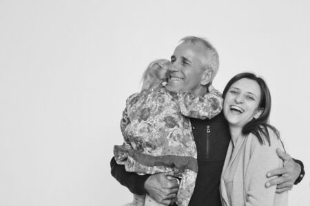 family photo on a white background: parents spend time with their children. mom and dad hug the baby. the concept of childhood, fatherhood, motherhood, IVF