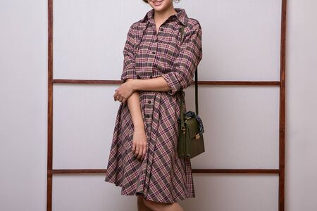 Retro-style. a girl from the 60s. The concept of advertising clothes, shoes, accessories