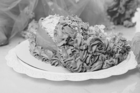 destroyed cake on white background close-up. Confectionery decorated with roses. Baking advertising concept, calorie, nutrition, diet
