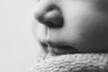 portrait of newborn baby. nose and lips close up. Concept of healthcare: diseases of the ENT, lips, mouth