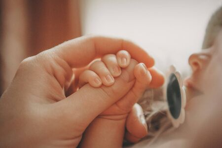 Babys hand, fingers close up. newborn baby arms, massage concept of childhood, health care, IVF, hygiene