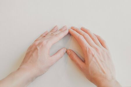 hands on white background. the concept of manifestation of emotions, gestures: heart Фото со стока