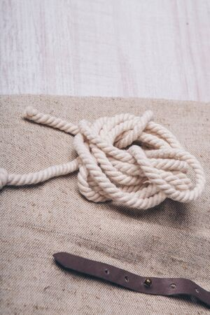 the concept of sewing accessories: a coil of rope. womens clothing accessory close up