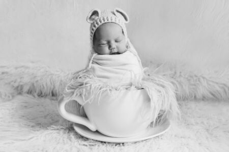 newborn baby in a large tea Cup. concept of childhood, health, IVF, hot drinks, Breakfast Stok Fotoğraf - 134409051
