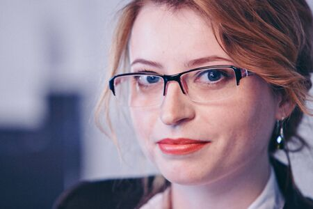 isolated photo: portrait of smiling handsome businesswoman in glasses. concept of healthy eyes, vision, professional skills