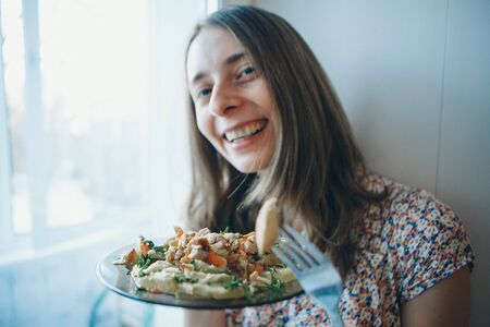 Portrait of a happy girl eating pizza. fast food advertising, pastry, cooking, overeating, diet, Italian food