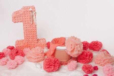 the concept of a festive interior, attributes of a holiday, decorative elements: number one, flowers, basket on a white background. Copy space Stok Fotoğraf - 135868880
