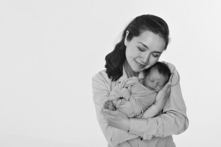the concept of a healthy lifestyle, the protection of children, shopping - baby in the arms of the mother. Woman holding a child. Isolated on white background. Copy space Stok Fotoğraf