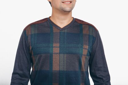 the concept of advertising clothes, fashion show-men's hoodies, shirts on a white background. Ornament and colors, decorative elements: stripes, locks, patches. Copy space