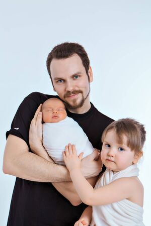 Dad holds the baby in his arms. Small child. The concept of educating the father of young children, Happy childhood, a friendly family, raising small children by a father.Copy space
