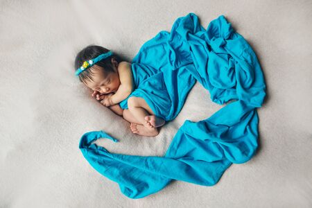 the concept of healthy lifestyle, IVF - a newborn baby sleeps under a blanket. Copy space Stok Fotoğraf