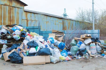 pile of waste in a container. garbage collapse. Janitors ' strike. environmental disaster of plastic recycling