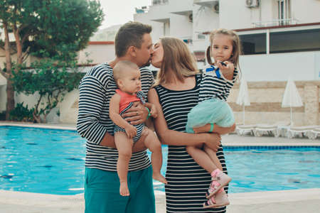 Ramile with children walks by the pool. Holidays in hot countries. the territory of the hotel