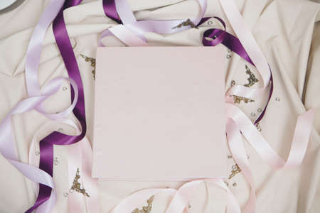 white book wrapped in leather on a white background. photo album from with a pure cover copy space. Greeting card