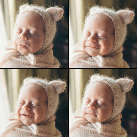 a newborn baby is smiling. A small child in a hat with ears. children's fashion Stok Fotoğraf