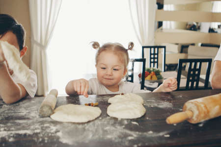 the baby makes cakes. the children were covered in flour. dinner at the bakery. feast in the kitchen