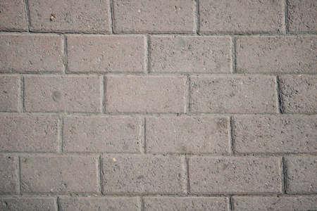 Textured: asphalt brick close - up as background