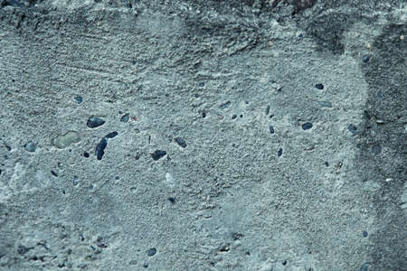 Textured: gray asphalt close - up as background