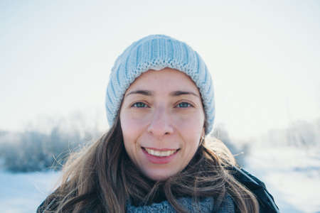 portrait of a beautiful girl in a hat on the background of the snow landscape in the cold season. winter walking Stock fotó