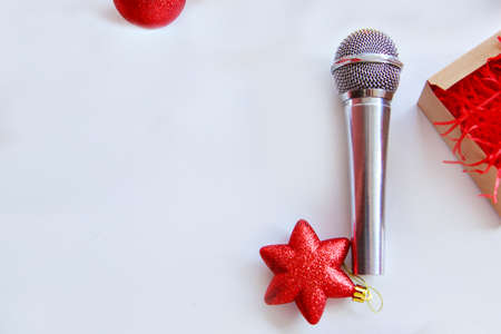 Christmas shopping: microphone and Christmas toys. Musical creativity in the new year. isolated on a white background. copy space