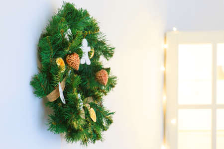 holidays, New year, decor and celebration concept - a large Christmas wreath decorated with toys