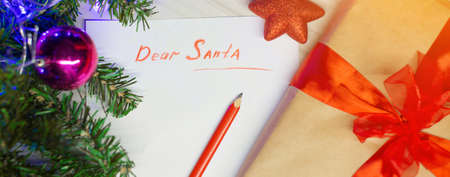 the concept of celebrating Christmas at midnight. holiday decor ,. letter to Santa Claus, wish list, gifts