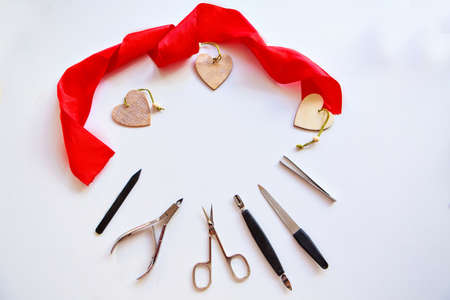Nail accessories and hearts for Valentine's Day. Purchase of manicure products. manicure set for February 14. Visiting a beauty salon during the holidays. isolated on a white background