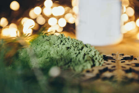 juice from wheat germ. matcha tea. bokeh as background. drink for the new year