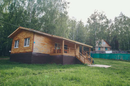 summer wooden house in a birch grove. camping in the woods. tourist base for travelers' recreation. eco-friendly construction