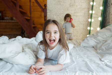 morning girls: the children playing in bed. waking up from a dream. I just woke up