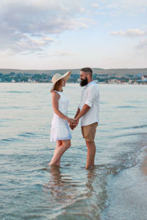 a guy and a girl on the sea. Couple love in water. people on the beach Standard-Bild