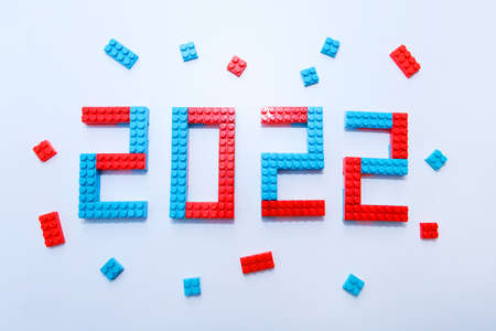 New year, 2022. Lettering from a childrens constructor on a white background. Toys in isolation. copy space. The concept of a hobby and learning Standard-Bild