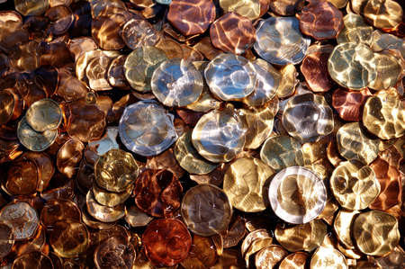 money,euro coins under water,suitable for background and texture
