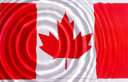 Canada flag under water with nice cirgles and ripples photo